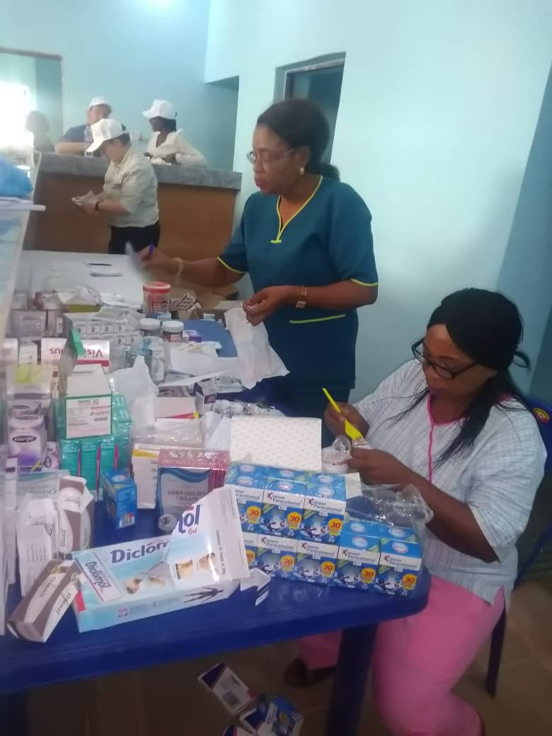 Nurses helping to dispense medication